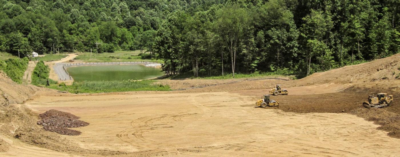 Three Bulldozers At Job Site