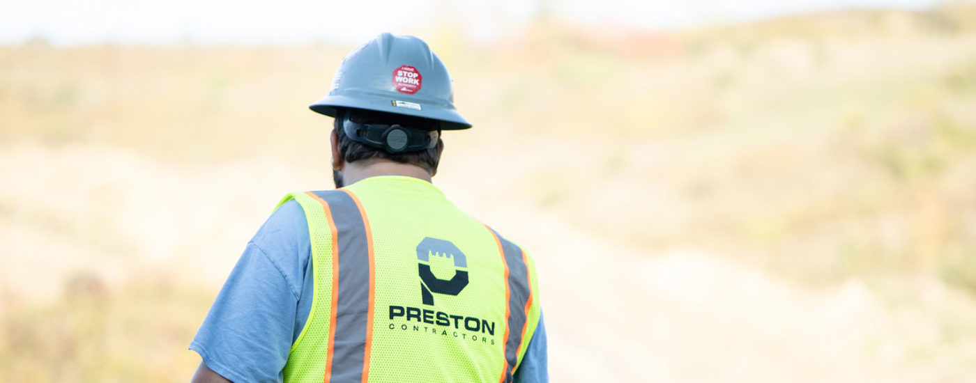 Preston Contractors Employee Wearing Hard Hat & Neon Vest