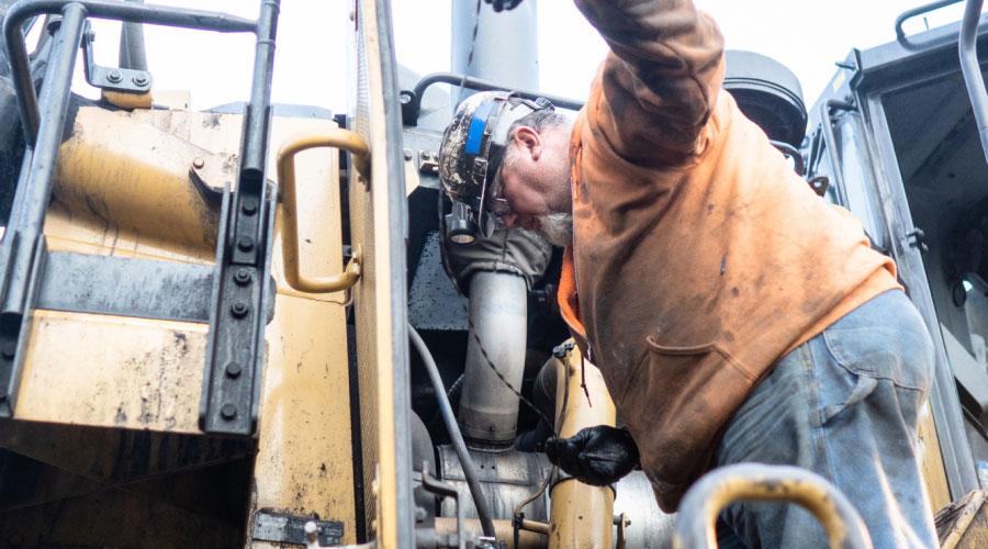 Preston Contractors Employee In Action Working With Heavy Equipment