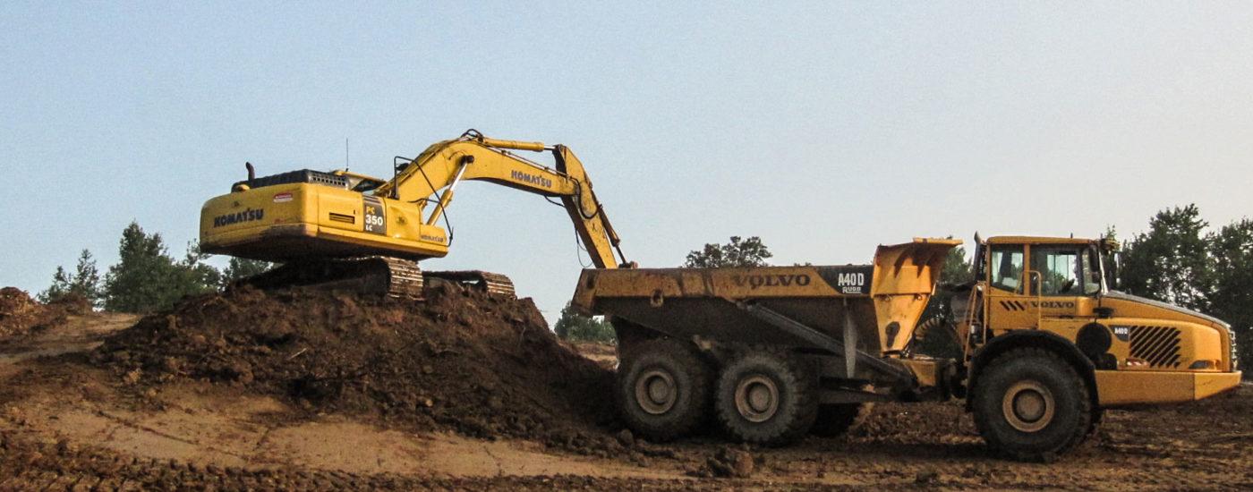 Komatsu K350lc Loading Dirt Onto A40d Volvo Truck At Job Site