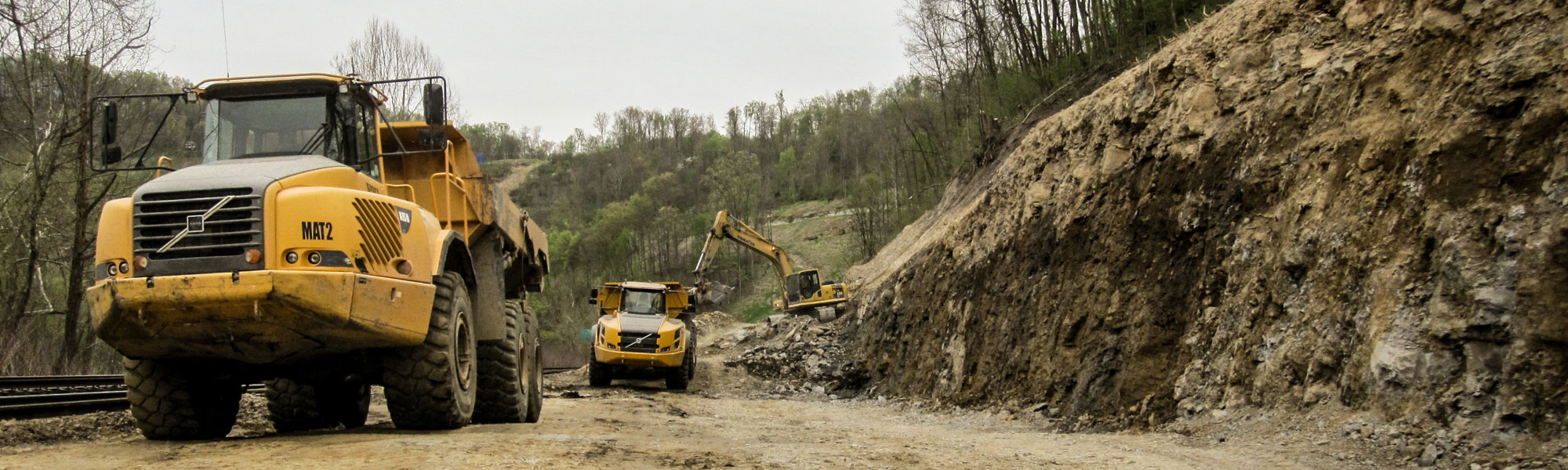 Heavy Equipment & Dump Trucks At Job Site